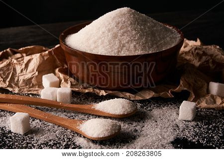 Bowl And Spoon Full Of White Sugar And Sugar Cubes