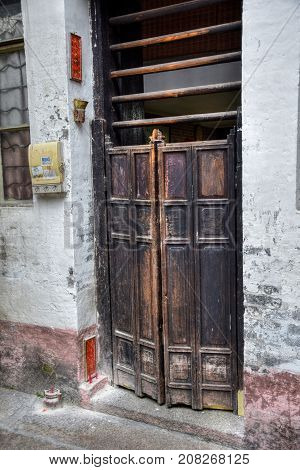 The traditional old-fashioned sliding wooden poles door in Canton in China.