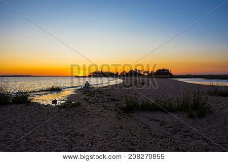 A sandbar at sunset along Sandy Hook Bay along the New Jersey coastline.