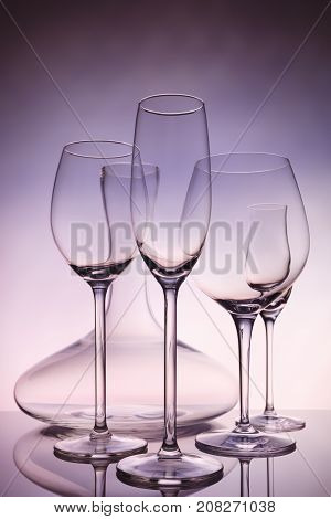 Glassware Selection With Wine, Champagne, Liquour Glasses And Decanter On Creative Background