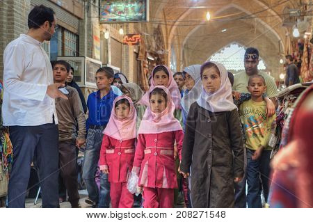 Fars Province Shiraz Iran - 19 april 2017: Iranian group of primary school children visited market or Vakil Bazaar.
