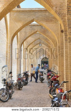 Fars Province Shiraz Iran - 19 april 2017: Arched street adjoining Vakil bazaar with Parking places for motorbikes.