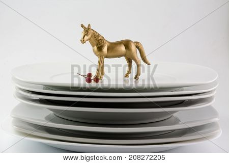 Dishes Plates Stacked White And Clean Tableware And Gold Horse, Conceptual Food.