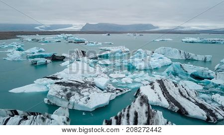 Aerial over icebergs floating in Jokulsarlon Lagoon by the southern coast of Iceland.