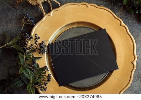 Gold Place Setting With Empty Menu On Grunge