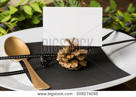 Christmas place setting, place name in pinecone on the plate