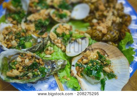 Fresh Oysters In A  Plate With Spice And Lemon
