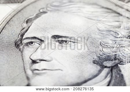 focus on the eyes president hamilton face on the ten dollar bill, photo close up
