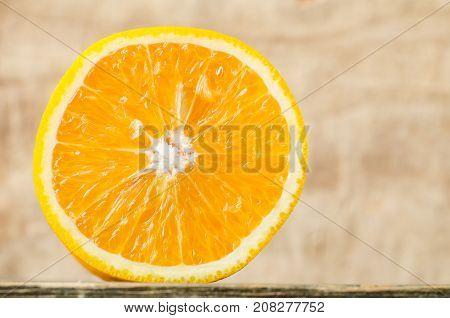 Half of Navel orange fruit on wooden background