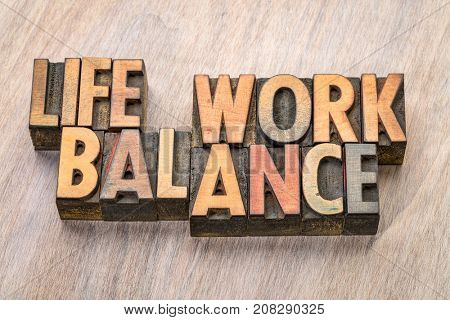 life work balance  - word abstract in vintage letterpress wood type printing blocks