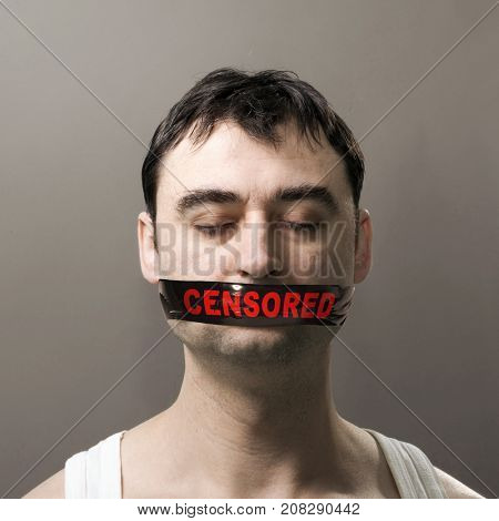 man's portrait with black censored tape on his face