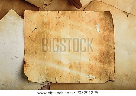 old grunge paper background on torn medieval scrolls document