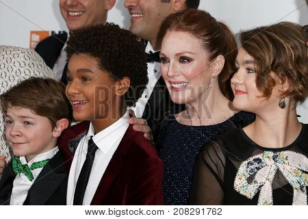 NEW YORK-OCT 07: (L-R) Oakes Fegley, Jaden Michael, Julianne Moore & Millicent Simmonds at