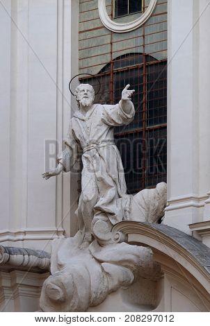 ROME, ITALY - SEPTEMBER 01: Stucco statue of St Francis Receiving the Stigmata on the facade of Santissime Stimmate di San Francesco church, Rome, Italy on September 01, 2016.
