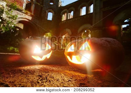 Evil grins of jack-o-lanterns burning on halloween night