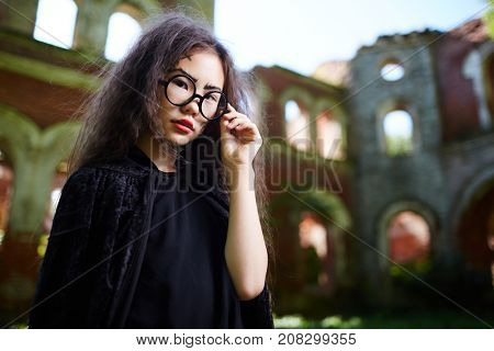 Little girl with long hair wearing black attire on halloween day