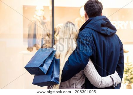 Couple looking at shopping window for Christmas