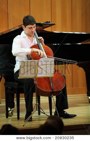 MOSCOW - JANUARY 14: Narek Hakhnazaryan plays on Antonio Stradivari cello in organ hall of Museum of Musical of Culture named Glinka on January 14, 2011 in Moscow, Russia.