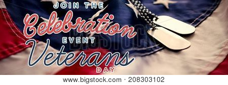 Logo for veterans day in america  against dog tag chains on flag