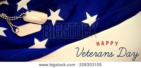 Logo for veterans day in america  against dog tag chains on an american flag