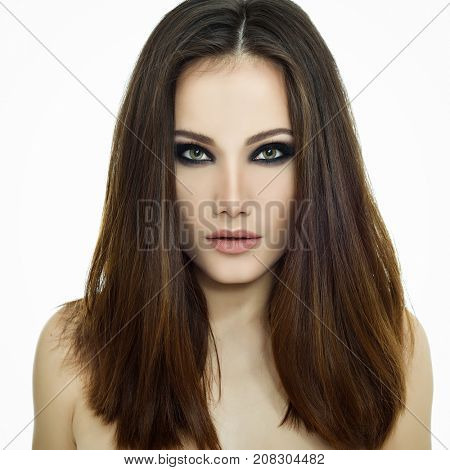 Majestic woman's beauty. Portrait of beautiful girl gazing at camera with healthy skin and strong brown long hair over white background. Beauty treatment, cosmetology, spa, health care