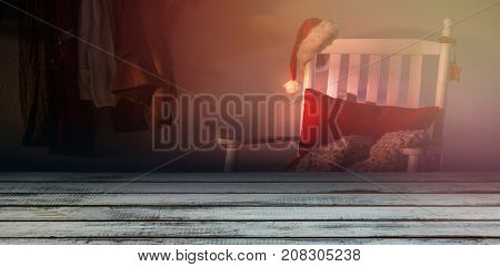 Full frame shot of weathered plank against wooden chair with red pillow and santa hat