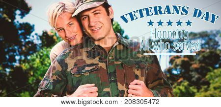 Portrait of simling army man with wife against logo for veterans day in america