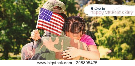 Army man hugging daughter with American flag against logo for veterans day in america hashtag