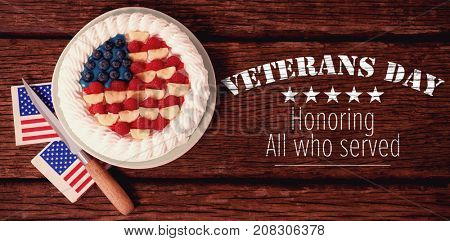 Logo for veterans day in america  against fruitcake with 4th july theme