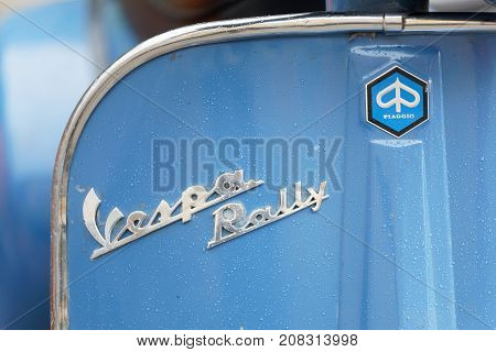 STOCKHOLM SWEDEN - SEPT 02 2017: Closeup of blue parked old fashioned classic vespa rally scooters at the Mods vs Rockers event at the Saint Eriks bridge Stockholm Sweden September 02 2017
