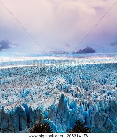 The spectacular glacier Perito Moreno, located in the national park of Los Glaciares in Patagonia. The world's third largest fresh water reserve. The concept of active and extreme tourism