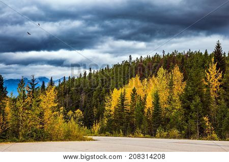 Heavy storm clouds over the mountains. The concept of active and automobile tourism. The road 93