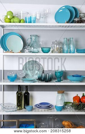 Storage stand with tableware, indoors