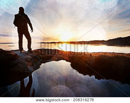 Tourist Guy Taking Pictures Of Amazing Sea Landscape On Mobile Phone Digital Camera. Hiker Stay On A