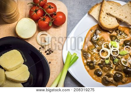Mushroom Goulash Served With Bread, Dumpling And Onion
