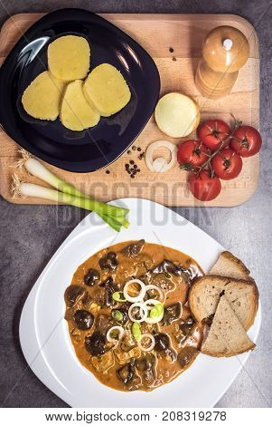 Mushroom Goulash Served With Bread, Potato Dumpling And Onion