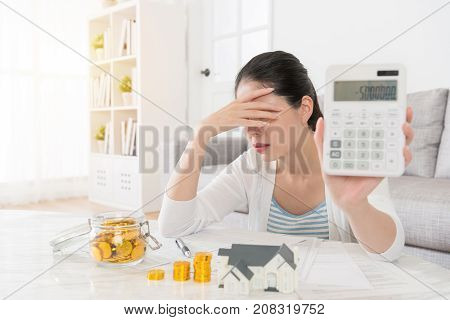 Woman Using Calculator Counting Personal Deposit