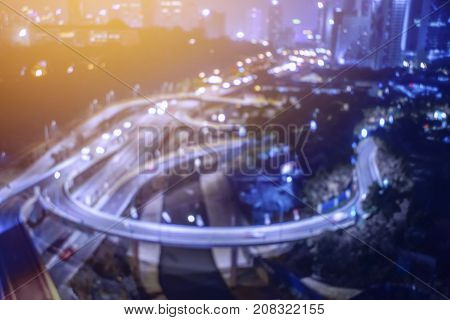 Blur Image Of Busy Highway At The City During Night.