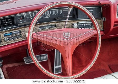 Vintage Cadillac Interior - Steering Wheel With Logo And Dashboard (focus On Steering Wheel)