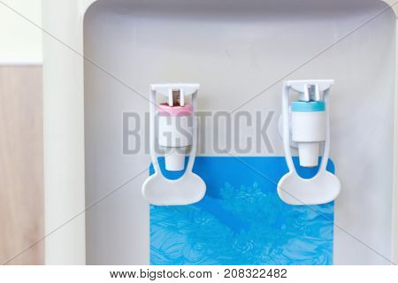 water cooler in the form of a portrait of a smiling man
