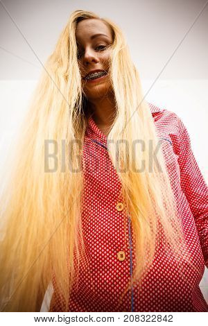 Woman Showing Her Long Blonde Hair