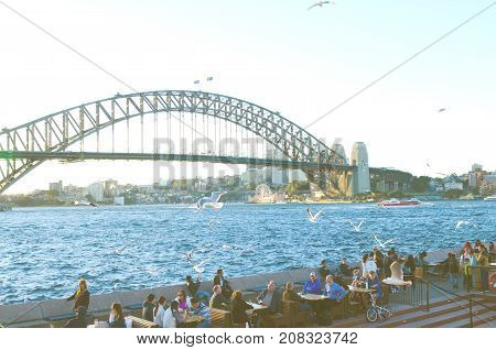 Sydney Australia - August 16 2017: People eating and drinking at the Opera Bar next to the Sydney Opera House. With harbour views and live music it is one of Sydney's most popular destinations.