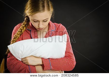 Sad Depressed Girl In Bed Gripping Pillow