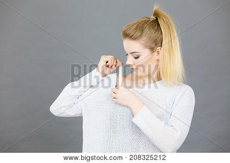 Woman Holding Her Bra Strap