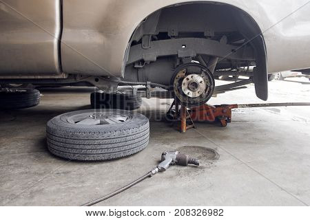 Changing car wheel in garage. Tools and accessories about car. Rear wheel.