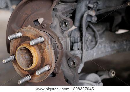 Close up of old hub wheel car. Rust on hub wheel. Front wheel.