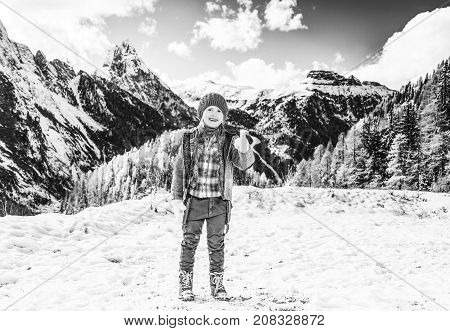 Girl Against Winter Mountain Landscape Showing Thumbs Up
