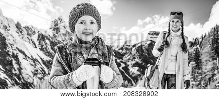 Mother And Daughter Tourists With Thermos Travel Mug
