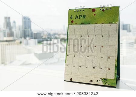 isolated creative design April calendar on office desk for appointment reminder