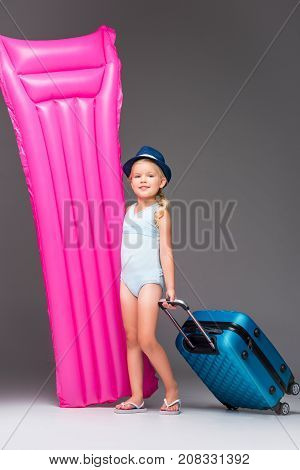 Child With Suitcase And Swimming Mattress